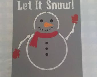 Snowman says let it snow!