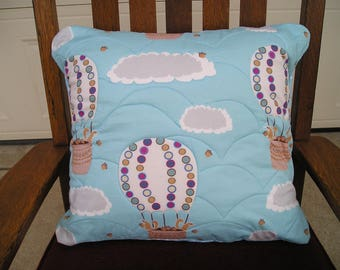 Pillow cover with squirrels and hot air balloons