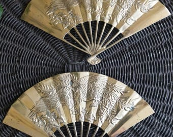 Set of two Oriental brass wall fans