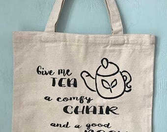 Give me tea, a comfy chair and a good book Tote