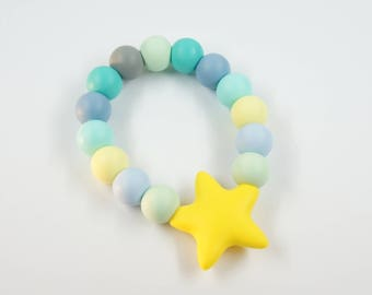 Baby teether toy with wood and silicone beads and silicone star