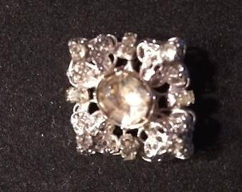 Vintage rho stone brooch