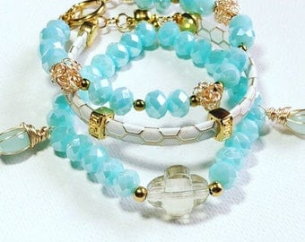 Three bracelets aqua crystals