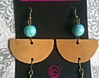 Handmade leather earrings with a turquoise stone