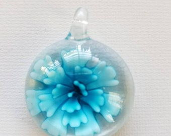 Blue and white flower glass pendant.