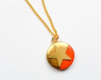 Brass star locket with orange detail