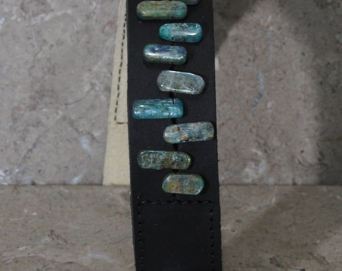9 Fluorite chips on black leather wrist band