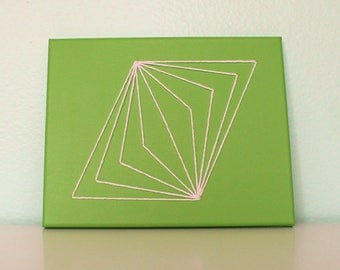 Green and white midcentury modern string art wall hanging
