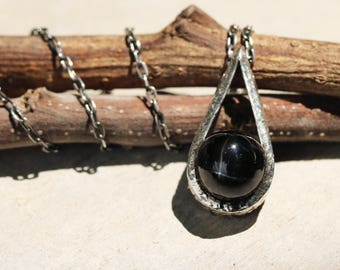 Silver teardrop pendant necklace with round cabochon black star diopside gemstone and oxidized sterling silver chain