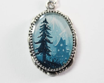 The House in the Alpine Mountains on a Snowing Evening Oval, a Hand-painted Watercolor Necklace in Silver