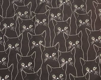 Cats with silver on black by Hoffman - 2 yards