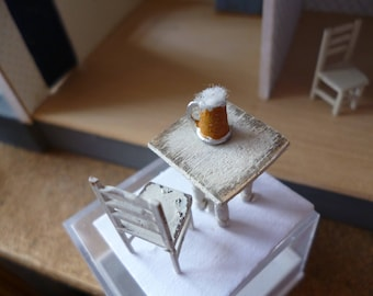 A Tiny one quarter inch scale table and chair with a pint of cold beer!