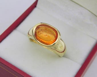 AAAA Orange Spessartite Garnet 3.6 carats  10.4x7.6mm in 14K Yellow gold bezel set ring.  254