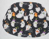 """Wedge shaped Halloween Winter reversible place mats with ghosts and """"let is snow"""" designs, set of 4"""