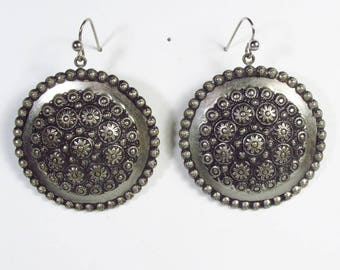 Round silver repousse floral metal drop dangle earrings.