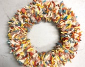 Custom yellow, orange, and teal wreath with handmade ceramic button accent