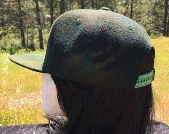 Black, Green, and Gold Flat Brim Snapback Hat with Leaf