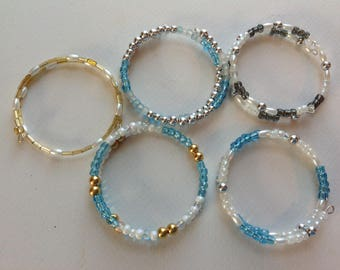Five shiney bracelets