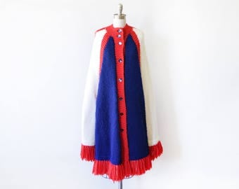 60s sweater cape, vintage 1960s red white and blue poncho, mod blanket poncho, knit sweater fringe poncho,