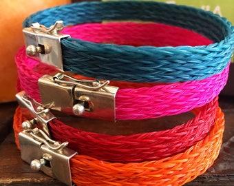 Stacked bracelets   Turquoise bracelet   Woven bracelet   Red bracelet   Orange bracelet   Pink bracelet   Hand made bracelet