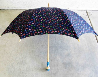 Vintage Umbrella in Navy Blue with Umbrella Pattern. Wooden French School Girl Handle. Circa 1970's.