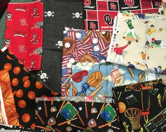 Lot of Boys sports fabric great for quilts or pillows etc. 4 3/4 yards and lots of useable remnants