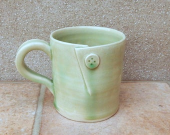Coffee mug tea cup with a button wheel thrown in stoneware pottery ceramic handmade handthrown