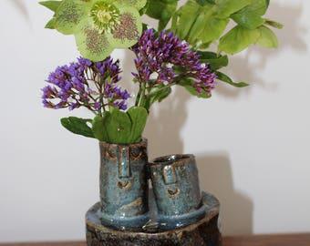 Two headed stoneware ceramic vase