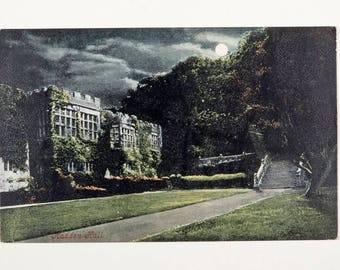 Vintage postcard of Haddon Hall in Derbyshire, moonlight scene, early 1900s, spooky picture of a historic house in England, used postcard.