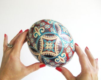 Ostrich egg Pysanka by Katya Trischuk turquoise and red