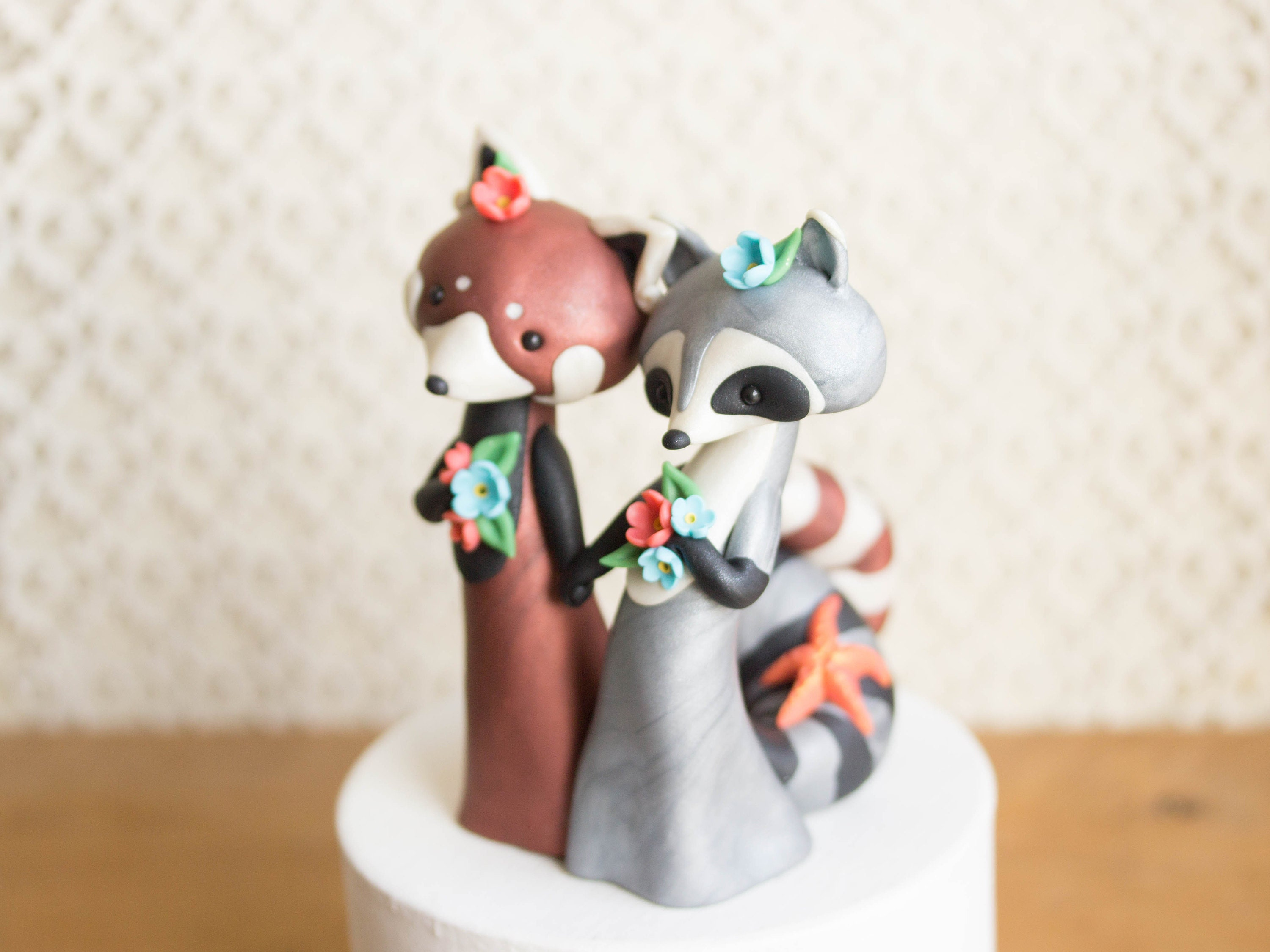 raccoon and red panda wedding cake topper