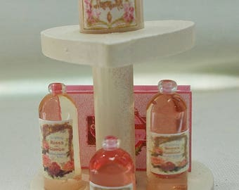 Dolls House Miniature Heart shop toiletries boxes and bottles display.