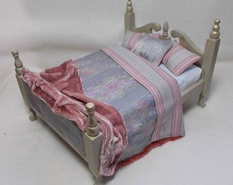 Dolls house miniature French style green Bed in printed silk and cotton fabrics in blues and pinks with pink velvet throw
