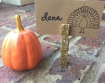 turkey . place setting cards . Thanksgiving + gold . glitter clothespins .