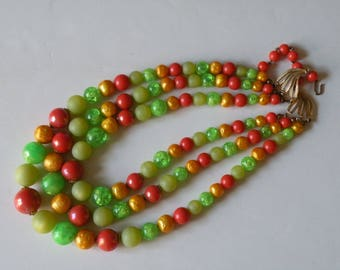 Green, orange, red brick color plastic beaded necklace. 3 strand
