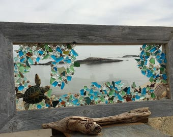 Sea turtle swimming in teal and blue beach glass