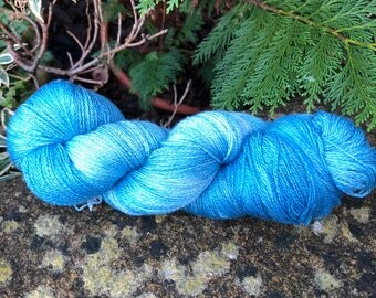 "Hand painted merino /silk lace weight yarn."" Pale sky's"""