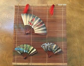 Hanging Japanese Fan display and one new fan.