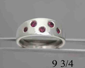Garnet and silver ring, size 9 3/4, 5 flush set stones, #561.
