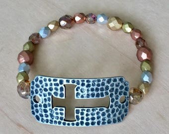 One of a kind, handmade metallic beaded bracelet with silver plate with cross cut out