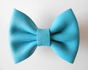 Big blue bow french leather of 5.5 x 4 cm