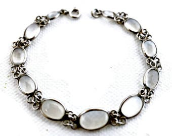 Vintage Sterling Silver And Oval Cabochon Moonstones With A Bezel Setting Bracelet