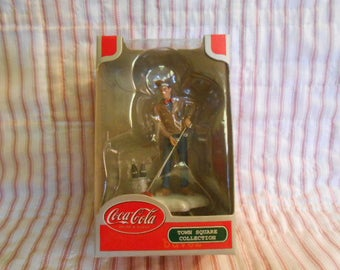 Town Square Collection-Coca Cola-Man Pushing Off  The Snow-Sealed
