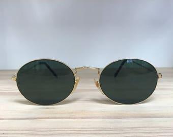 Gold greenish gray lens oval vintage sunglasses