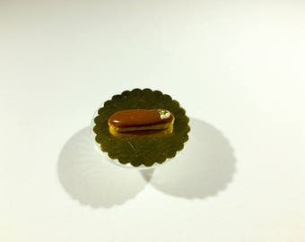 Miniature Flash caramel icing and decoration of polymer clay gold leaf