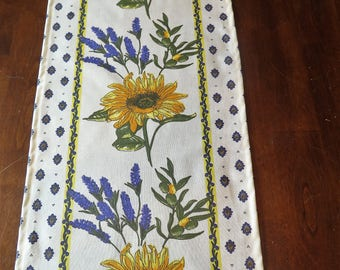 Table Runner. Oilcloth, cotton coated. Fabric from Provence, France. 84'' long. Sunflowers in white.Matching Napkins.