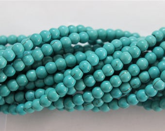 a strand of 80 turquoise beads 6mm round