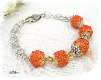 "Bracelet orange ""sugar"" and BR691 silver glass beads"