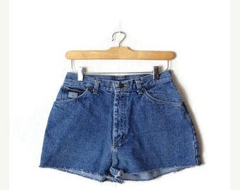 ON SALE Vintage Wrangler Blue Denim Cut off Shorts from 90's/W25*