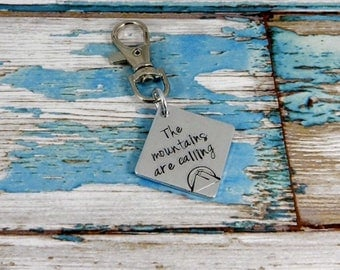 The mountains are calling! Aluminium hand stamped square climbin/chalk bag clip.
